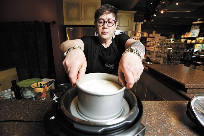Marilee Kinsella uses her pressure-cooker to make cheesecake. - YOUNG KWAK