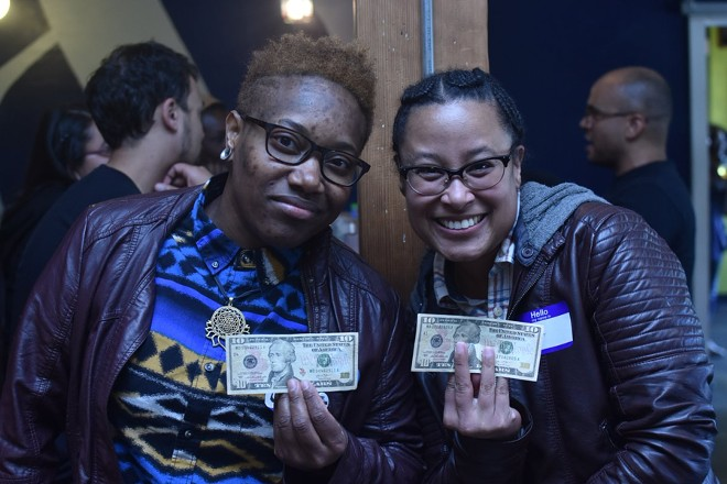 "In an undated photo provided by the event organizer, Adia Gibbs, left, and Tina Valeria at a ""Reparations Happy Hour"" held in Portland, Ore. Organizers invited black, brown and indigenous people to a bar and handed them $10 bills a small but symbolic gift funded mostly by white people, who were asked not to attend. - CAMERON WHITTEN VIA THE NEW YORK TIMES"
