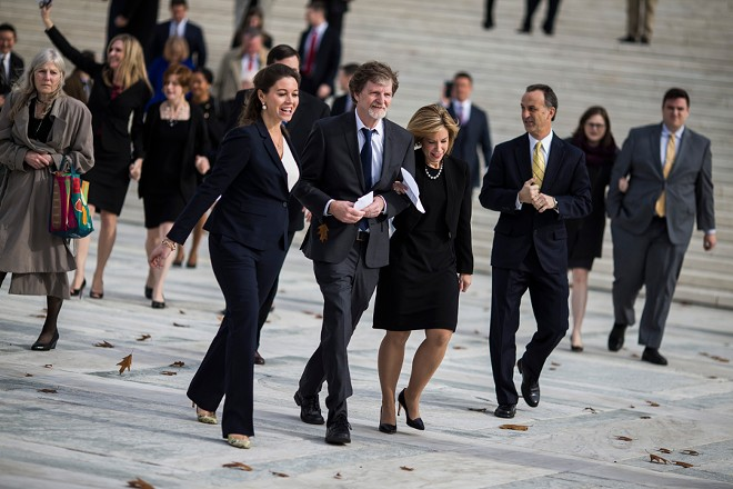 Jack Phillips, center, the baker who was convicted under a Colorado anti-discrimination law for refusing to make a wedding cake for a gay couple, outside the Supreme Court building in Washington, Dec. 5, 2017. The court sided with Phillips on June 4, 2018, in the closely watched case pitting gay rights against claims of religious freedom. - ZACH GIBSON/THE NEW YORK TIMES