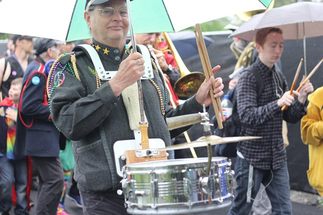 Musicians perform in the rainy day parade. - QUINN WELSCH PHOTO