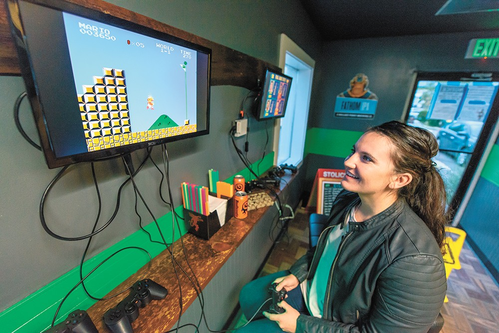 Brooke Wayman takes on Super Mario Bros. at GeeksNGlory. - ERICK DOXEY PHOTO