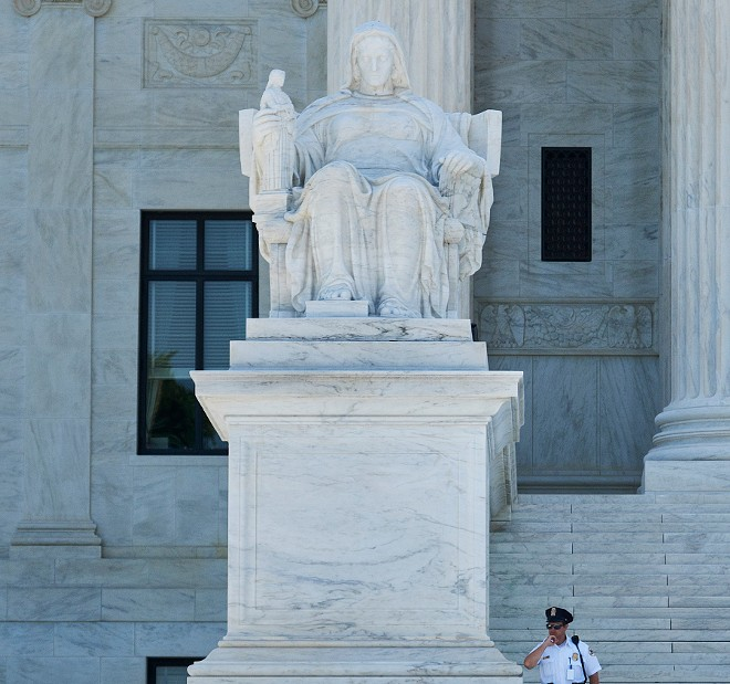 The Contemplation of Justice sculpture outside the Supreme Court in Washington, June 29, 2018. President Trump is expressing fresh interest in Judge Thomas Hardiman, the runner-up for last year's Supreme Court vacancy, as he pushes his decision on a replacement for Justice Anthony Kennedy into the final hours before his self-imposed deadline of July 9, three people close to the process said. - T.J. KIRKPATRICK/THE NEW YORK TIMES
