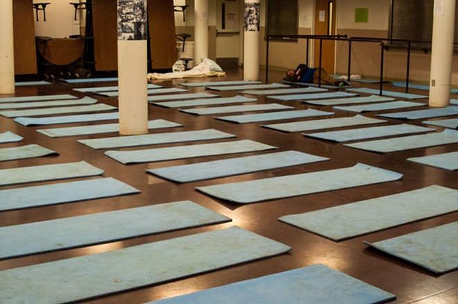 Mats for sleeping inside the House of Charity. - DANIEL WALTERS PHOTO