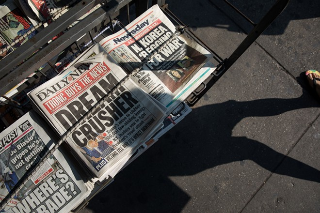 Copies of The New York Daily News on sale in Manhattan, the day after the paper was sold to Tronc, Sept. 5, 2017. Reporters and editors at The Daily News were been told that the newsroom staff was being cut in half and that the editor in chief, Jim Rich, was out of a job on July 23, 2018. Grant Whitmore, an executive at Tronc, the media company that owns The News, presided over the meeting, which took place in its newsroom in Manhattan. The new editor in chief is Robert York, currently the editor and publisher of The Morning Call, a Tronc-owned daily newspaper in Allentown, Pa. - DAMON WINTER/THE NEW YORK TIMES