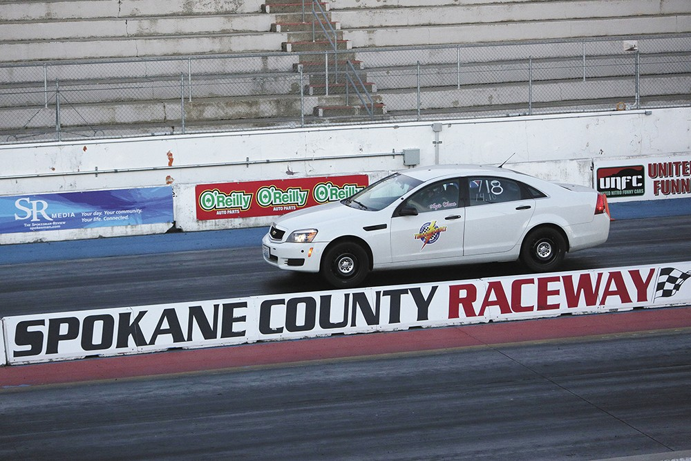 Angie Weaver steers her 2013 Chevrolet Caprice Police Interceptor down the track. - YOUNG KWAK