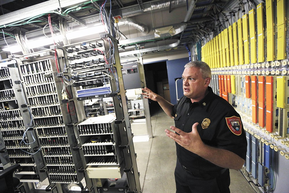 Spokane Fire Chief Brian Schaeffer showcases the innards of the Combined Communications Center — which currently holds multiple dispatch agencies.