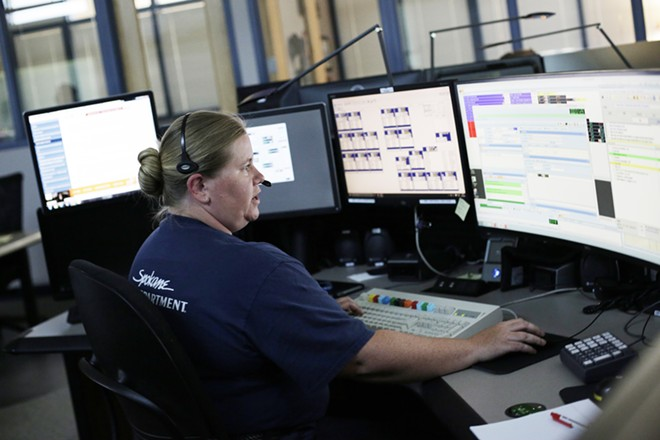 Spokane Fire Communications Specialist Cassidy Haas works on a call at the Fire Department's Combined Communications Building in Spokane. - YOUNG KWAK