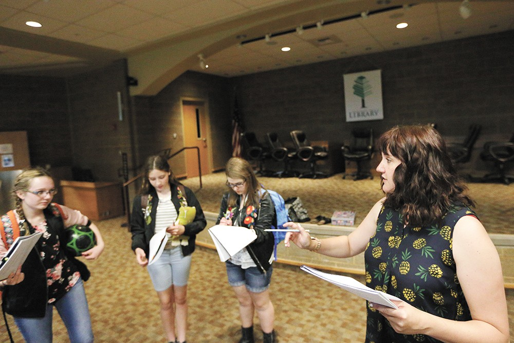 Brook Bassett (right) directs a scene featuring (left to right) Teagan Daniels, Becca McLachlan and Elisabeth Edmonds. - YOUNG KWAK