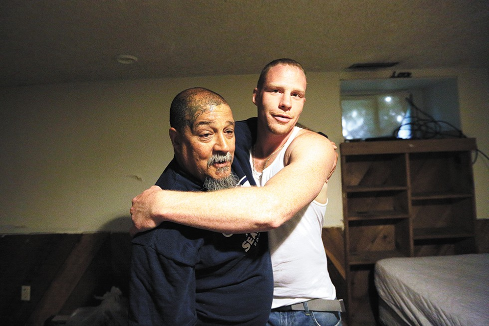 Randy Mora gets a hug from his new roomie Kyle Phillips on April 26. - YOUNG KWAK