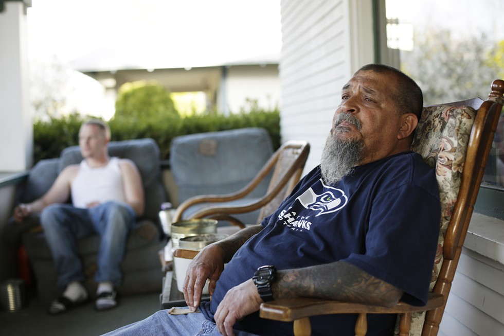 Randy Mora (right) sits on his front patio with Kyle Phillips, his roommate. - YOUNG KWAK
