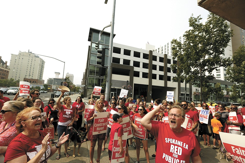 Spokane teachers picketed outside the district office last week, calling for a raise in advance of contract negotiations. - YOUNG KWAK