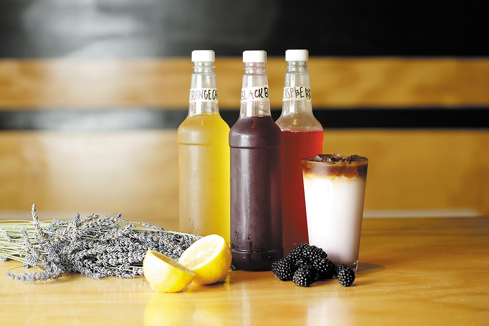 A sample of Revel 77's handcrafted syrups with a blackberry layered latte. - YOUNG KWAK