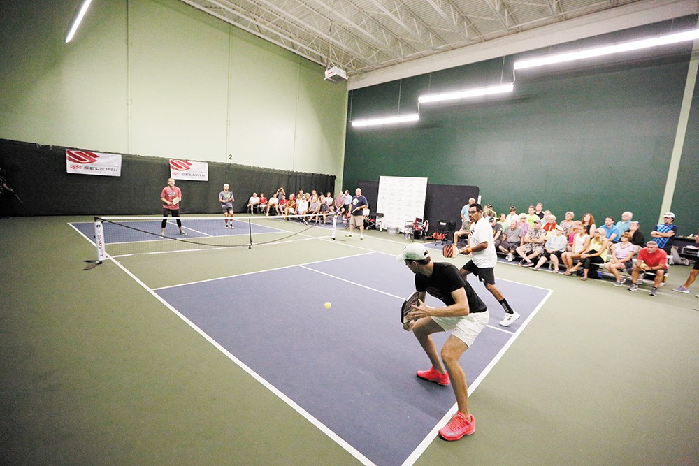 Selkirk Sport team member Kyle Thieme hits the ball during a doubles demonstration at North Park. - YOUNG KWAK