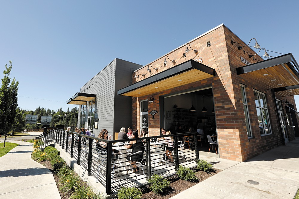 Patrons enjoy the new patio at Indaba Coffee in Kendall Yards. - YOUNG KWAK