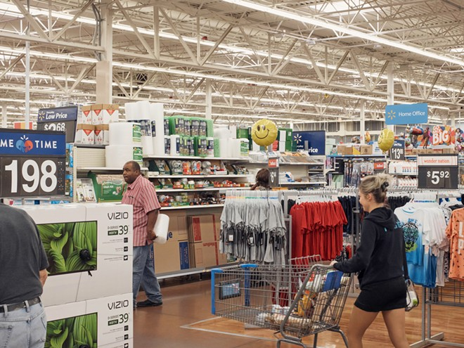Patrons inside a Walmart in Las Vegas, Aug. 16, 2018. Median household income, an important measure of the nation's economic health, rose in 2017 for the third straight year, the Census Bureau reported. - ROSS MANTLE/THE NEW YORK TIMES