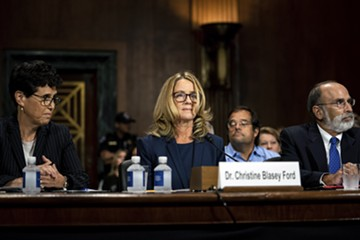 Christine Blasey Ford is flanked by her attorneys, Debra Katz, left, and Michael Bromwich at a Senate Judiciary Committee hearing in Washington on Thursday, Sept. 27, 2018. Blasey testified about her accusation that Judge Brett Kavanaugh, President Trump's Supreme Court nominee, sexually assaulted her. - ERIN SCHAFF/THE NEW YORK TIMES