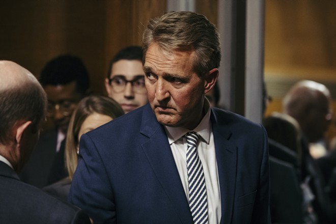 Sen. Jeff Flake (R-Ariz.) leaves a Judiciary Committee hearing where Judge Brett Kavanaugh's Supreme Court nomination was advanced to a full Senate vote,  on Capitol Hill in Washington, Oct. 3, 2018. Flake and Sen. Susan Collins (R-Maine) have both condemned President Donald Trump's mocking comments toward Christine Blasey Ford, who has accused Judge Brett Kavanaugh of sexual assault. - DAMON WINTER/THE NEW YORK TIMES