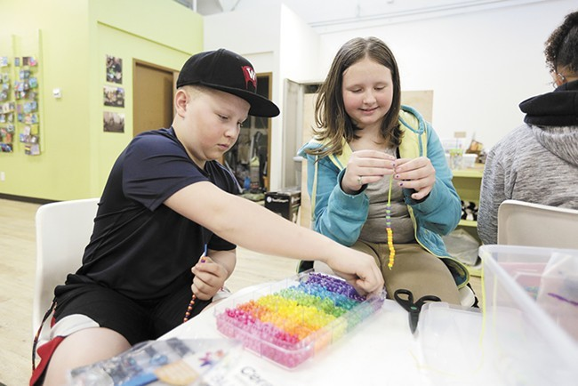 Students at PRIDE Prep — one of Spokane's charter schools —  in 2016. - YOUNG KWAK