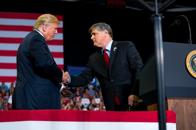President Donald Trump greets Sean Hannity onstage during a campaign rally at the Show Me Center in Cape Girardeau, Mo., Nov. 5, 2018. Trump was joined by a trio of conservative media rock stars on Monday as he wrapped up the midterm election cycle with a late-night rally in southwest Missouri. - DOUG MILLS/THE NEW YORK TIMES