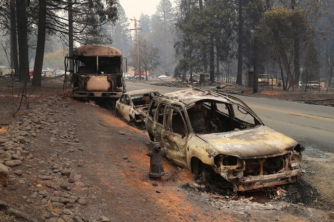 A line of vehicles that were abandoned along the road in Paradise, Calif., Nov. 11, 2018. Of the 23 people known on Sunday to have been killed by the fire in Paradise, six had died in their cars. - JIM WILSON/THE NEW YORK TIMES