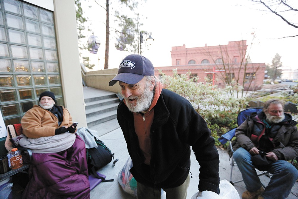 James Welch gathers donations from City Hall to pass out to those in need. - YOUNG KWAK
