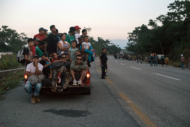 Migrants from Central America prepare to bed down for the night in the main square in Huixtla, in the southeastern state of Chiapas, Mexico, Oct. 22, 2018. The Trump administration enacted new immigration rules on Nov. 8 that give President Donald Trump vast new authority to deny asylum to virtually any migrant who crosses the border illegally, invoking national security powers meant to protect the U.S. against threats from abroad. - LUIS ANTONIO ROJAS/THE NEW YORK TIMES