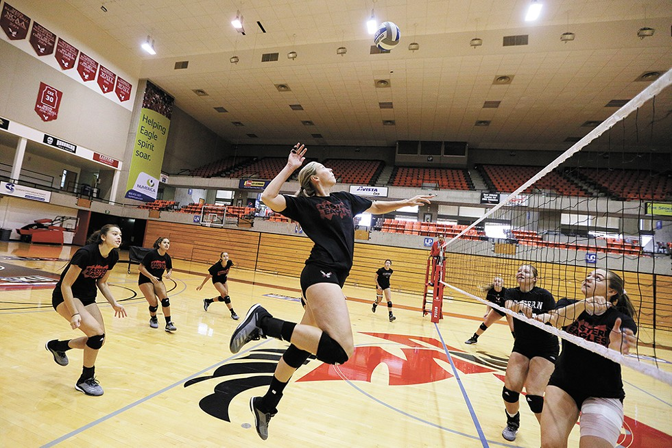 """SPIKED!"" - Eastern Washington's Taylor Larsen, center, during practice at Reese Court."