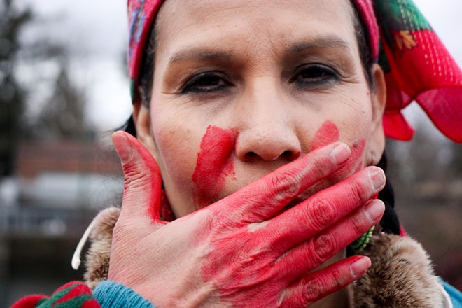 Ann Ford, a member of the Coeur d'Alene Tribe, wears the red handprint across her mouth. - QUINN WELSCH PHOTO