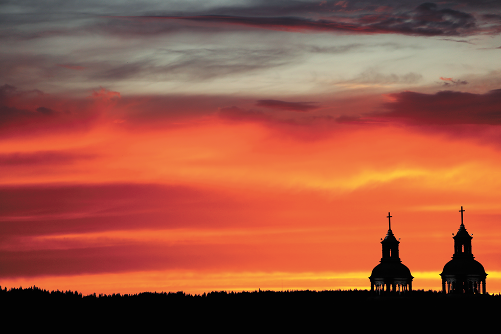 The Cathedral of Our Lady of Lourdes silhouetted against a Spokane sunset. Under Bishops Daly and Cupich, the Diocese of Spokane has had to climb back from the bankruptcy and abuse scandals that defined the tenure of their predecessor, Bishop William Skylstad. - YOUNG KWAK PHOTO