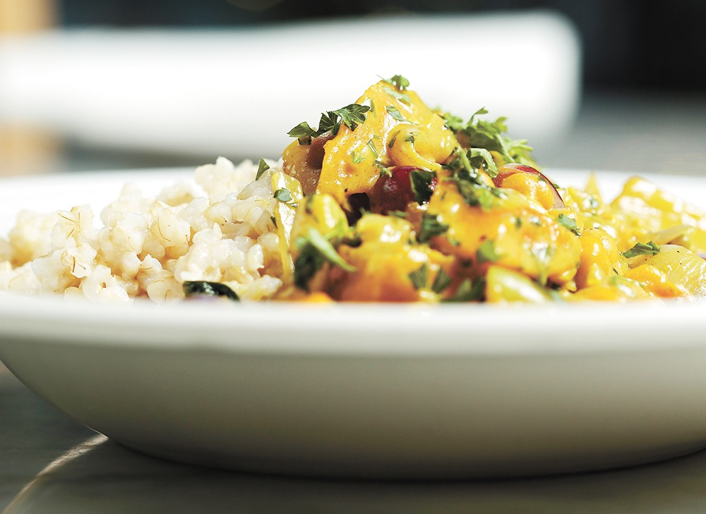 Mizuna loves its veggies, including this Moroccan chickpea tagine. - YOUNG KWAK PHOTO