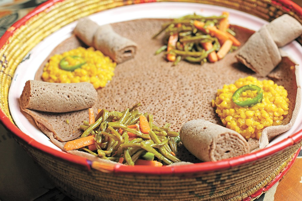 The bread is called injera and you'll want plenty of it to scoop up all the yummy flavors at Queen of Sheba. - YOUNG KWAK PHOTO
