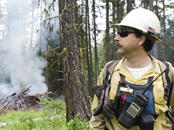 In this 2013 photo, Kent Contreras with the Forest Service helps oversee a wildfire training exercise near Usk, about an hour north of Spokane. - JACOB JONES PHOTO