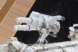In an image provided by NASA, Cmdr. Scott Kelly participates in a spacewalk outside the International Space Station, Dec. 21, 2015. For 340 days, NASA scientists meticulously compared Kelly to his earthbound twin, Mark. The results hint at what humans will have to endure on long journeys through space. - NASA VIA THE NEW YORK TIMES