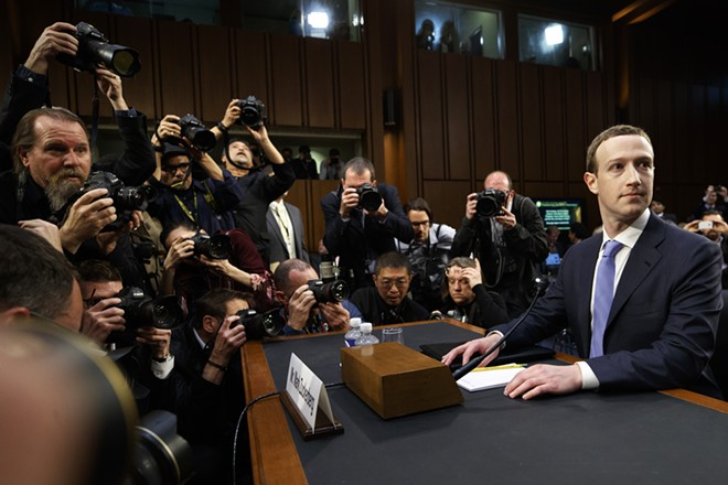 """Mark Zuckerberg, the chief executive of Facebook, arrives to testify at a joint Senate Judiciary and Commerce Committee hearing, on Capitol Hill in Washington, April 10, 2018. Facebook said on April 24, 2019, that it expected to be fined up to $5 billion by the Federal Trade Commission for privacy violations, in what would amount to a record penalty for a technology company by the agency. The social network disclosed the amount in its quarterly financial results, saying it estimated a one-time loss of $3 billion to $5 billion in connection with an """"ongoing inquiry"""" with the FTC Facebook added that """"the matter remains unresolved."""" - TOM BRENNER/THE NEW YORK TIMES"""