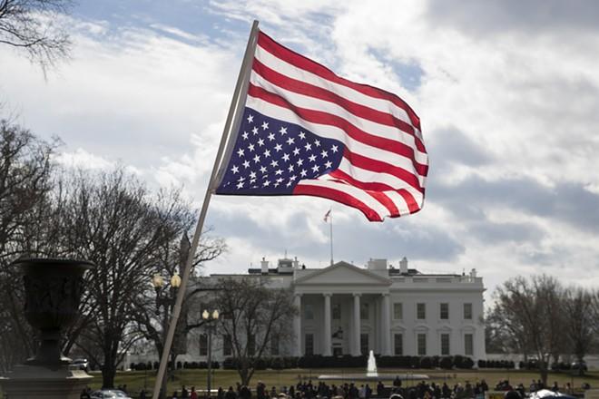 An upside-down American flag in front of the White House in Washington, Feb. 18, 2019. Last year, Americans reported feeling stress, anger and worry at the highest levels in a decade, according to a new Gallup poll of more than 150,000 people around the world. - SARAH SILBIGER/THE NEW YORK TIMES