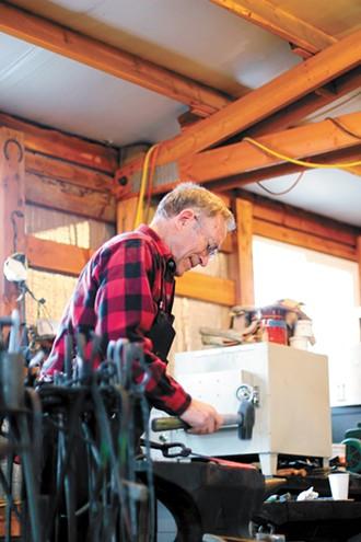 Steve McGrew at work in his shop. - CARRIE SCOZZARO PHOTO