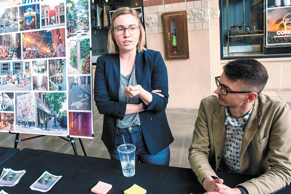 "Maren Murphy and Alex Mann gather feedback from River Park Square patrons about the city's ""Innovation Alleyways"" initiative. - DANIEL WALTERS PHOTO"