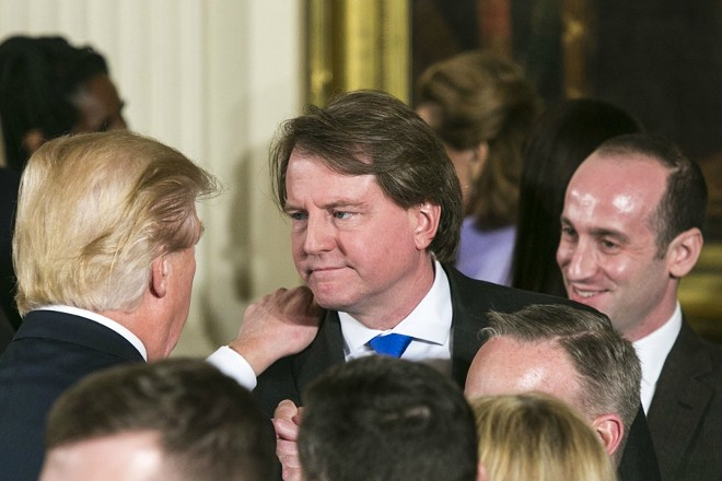 President Donald Trump with Donald McGahn, the White House counsel, at a swearing-in ceremony at the White House in Washington, Jan. 22, 2017. Trump ordered the firing of Robert Mueller, the special counsel overseeing the Russia investigation, in June 2017, according to four people told of the matter, ultimately backing down after McGahn threatened to resign over the directive. - AL DRAGO/THE NEW YORK TIMES