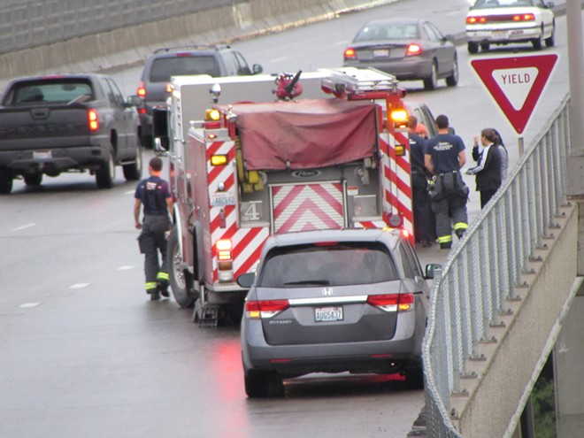 A FIRE TRUCK RESPONDS TO AN ACCIDENT ON MAPLE STREET BRIDGE