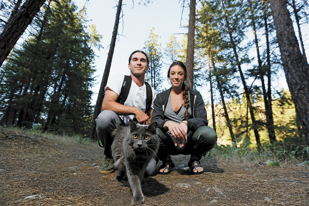 Brendan Love and Ryann Ensrud enjoy the natural world at Riverside State Park with their cat, Fisher. - YOUNG KWAK PHOTO