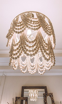 Inspired by a Pottery Barn fixture, Shannon Morscheck created her own wood-bead chandelier. - ERICK DOXEY PHOTO