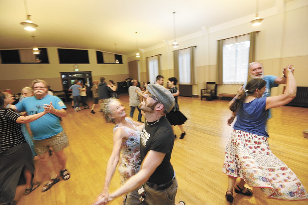 Contra dances are a weekly feature at the Spokane Women's Club. - YOUNG KWAK PHOTO