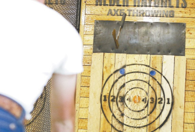 Axe throwing is like playing darts, but with really sharp hatchets. - YOUNG KWAK