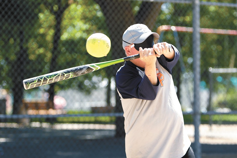 Spokane Lion Pride player Chris Annis fouls off a beep baseball during practice. - YOUNG KWAK PHOTO