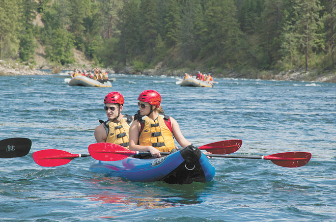 Recreational river users float in calm water before hitting rapids in the lower end of the Spokane River. - NICHOLAS GRAUERT PHOTO