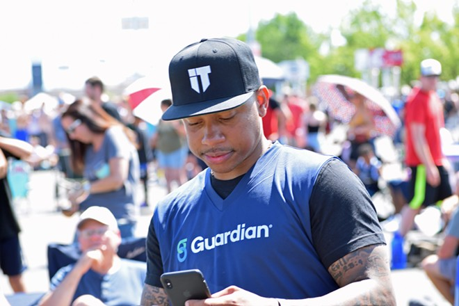 Isaiah Thomas presumably checking Twitter for free-agency news. - WILSON CRISCIONE