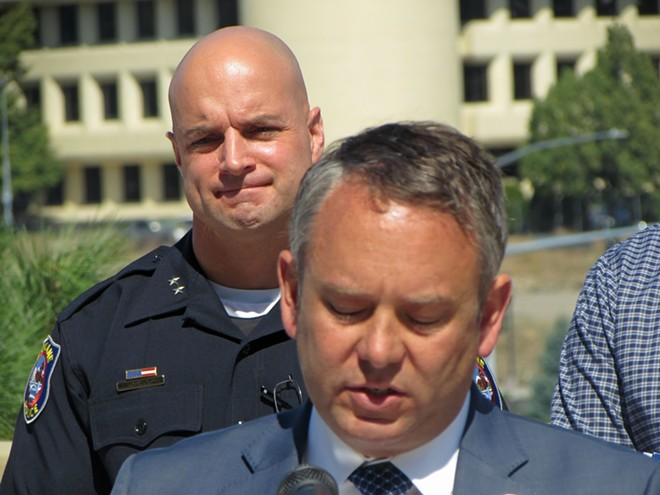Spokane Police Chief Craig Meidl stands behind Mayor David Condon during the police chief's 2016 appointment. Council President Ben Stuckart objected to how Meidl was initially hired, but has since become a big fan of the chief. - DANIEL WALTERS PHOTO
