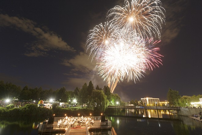 "The Royal Band, conducted b David Dutton, performs George Frideric Handel's ""Musick for the Royal Fireworks, 1749, as fireworks are set off over Riverfront Park, during the Royal Fireworks Concert, Sunday, July 26, 2015, in Spokane. - YOUNG KWAK PHOTO"
