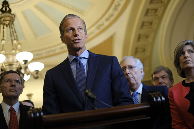 """Senate Majority Whip John Thune (R-S.D.) speaks during a weekly news conference with Senate leadership, on Capitol Hill, in Washington, June 18, 2019. Republicans, seeking a response to this weekend's massacres, are coalescing around such bills to help law enforcement take guns from those who pose an imminent danger. Thune said he was """"confident Congress will be able to find common ground on the so-called red flag issue."""" - GABRIELLA DEMCZUK/THE NEW YORK TIMES"""