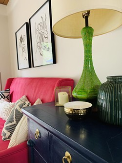 """The focal point is the hot pink settee, and we brought in - navy blue, various greens and brass accents with the lamp and accessories to complement the hot pink."" — Jana Oliveri - PHOTO COURTESY HUE"